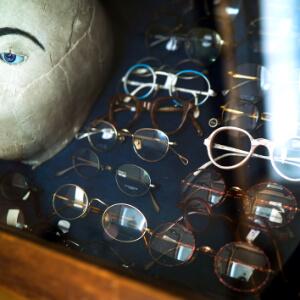 Vintage round spectacels in display case